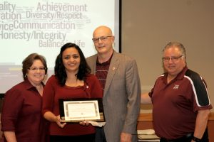 6/10/16: Diana Campos receives her Certificate of Completion at the ALTA Luncheon. (Photo by Victoria Palombit)